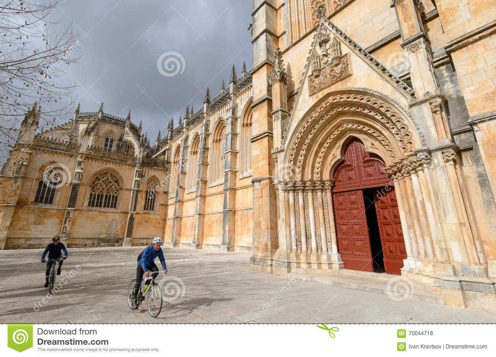 Batalha, Portugal - February 07, 2016: Two bikers riding near th