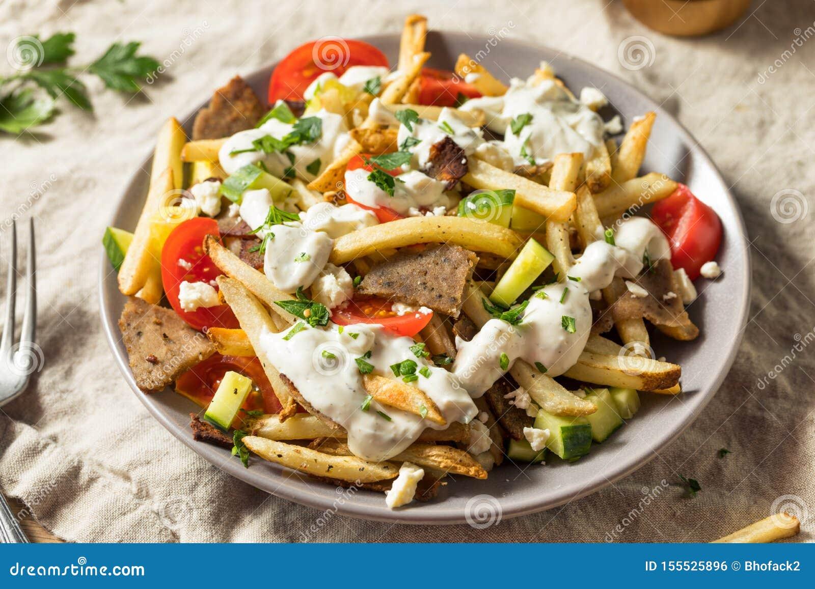 Batatas fritas gregas caseiros da carne do giroscópio