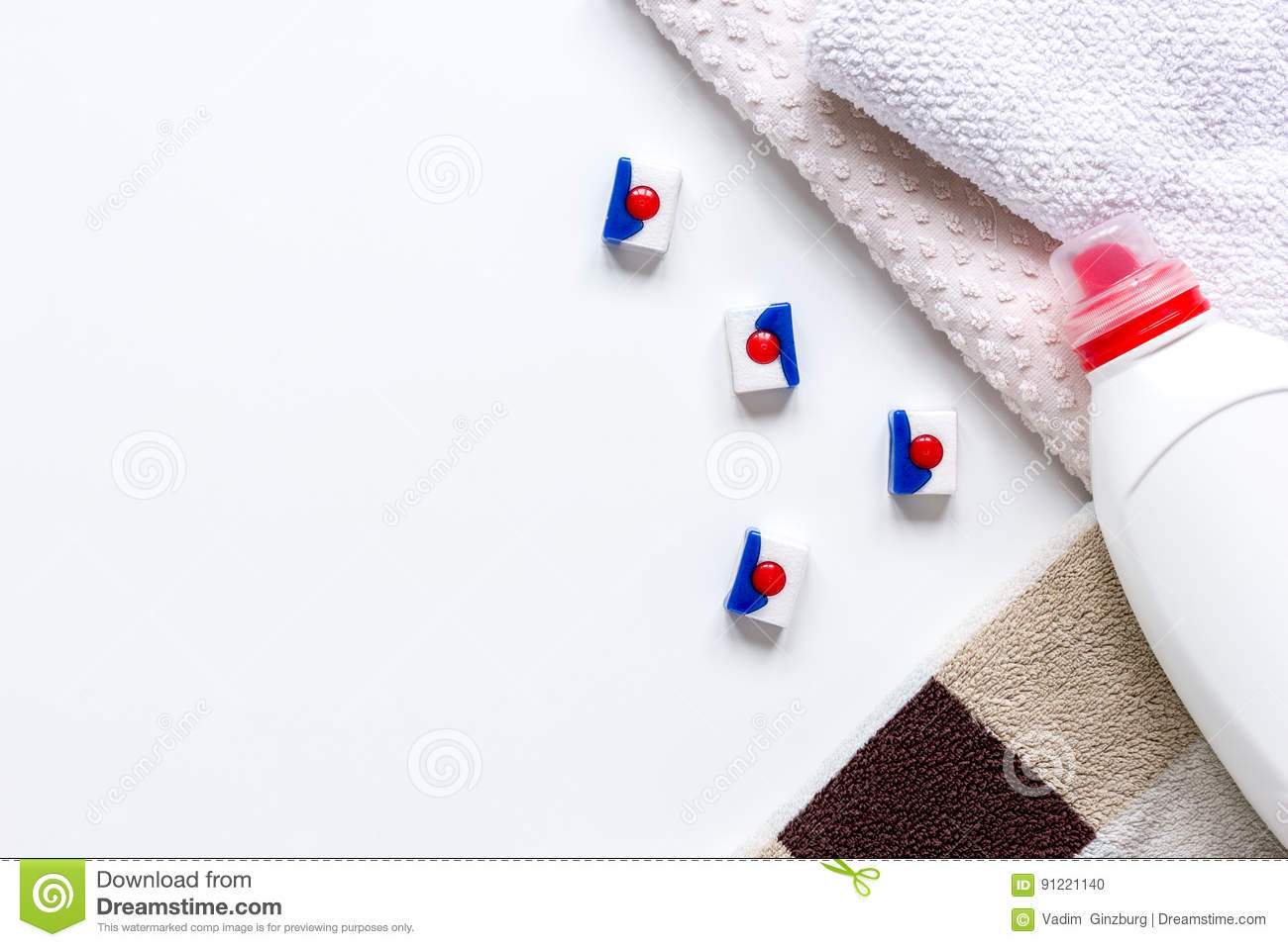 Bath Towels Stack With Detergent Bottle In Laundry Top