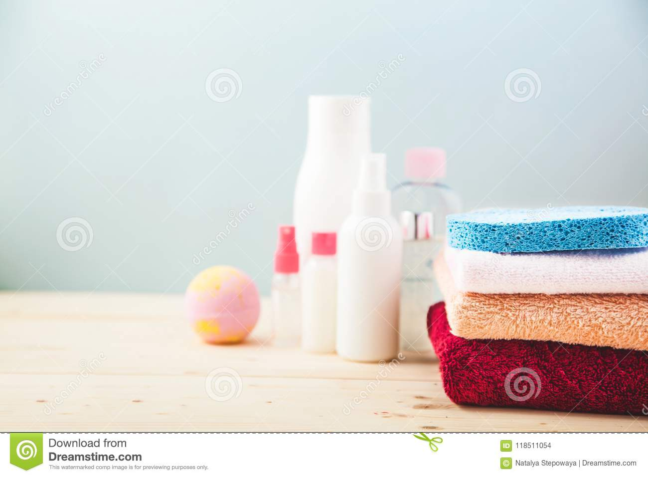 Bathroom Accessories - Towels. Cream And Shampoos On A Light, Bright ...