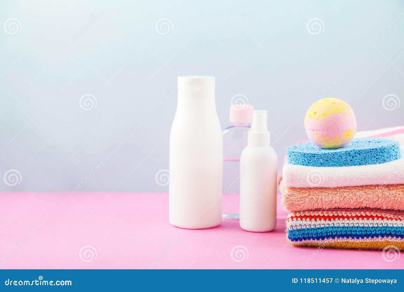 Bathroom Accessories - Towels, Cream, Bath Foam And Shampoos On A ...