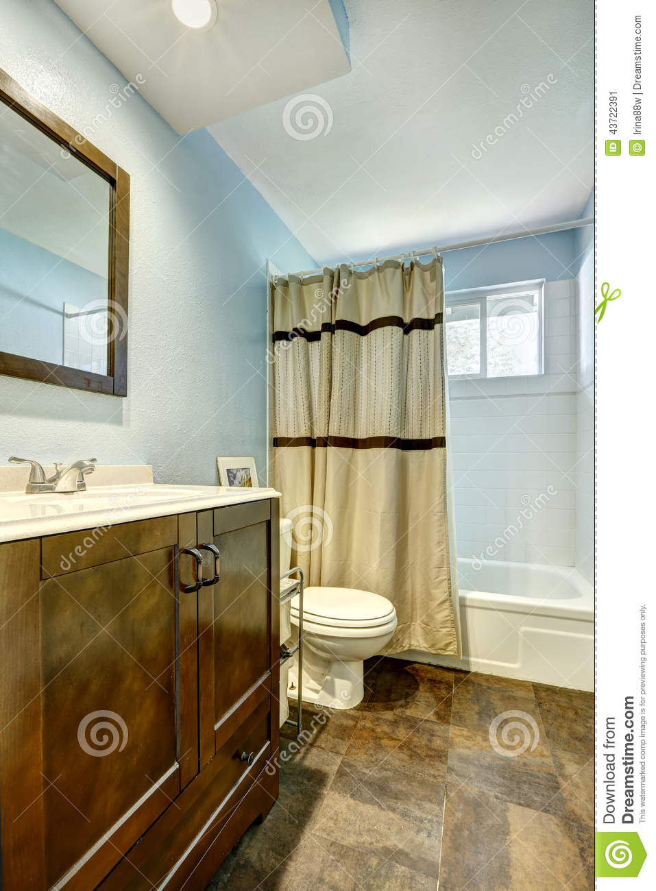 Bathroom with brown tile floor and light blue walls stock Bathroom colors blue and brown