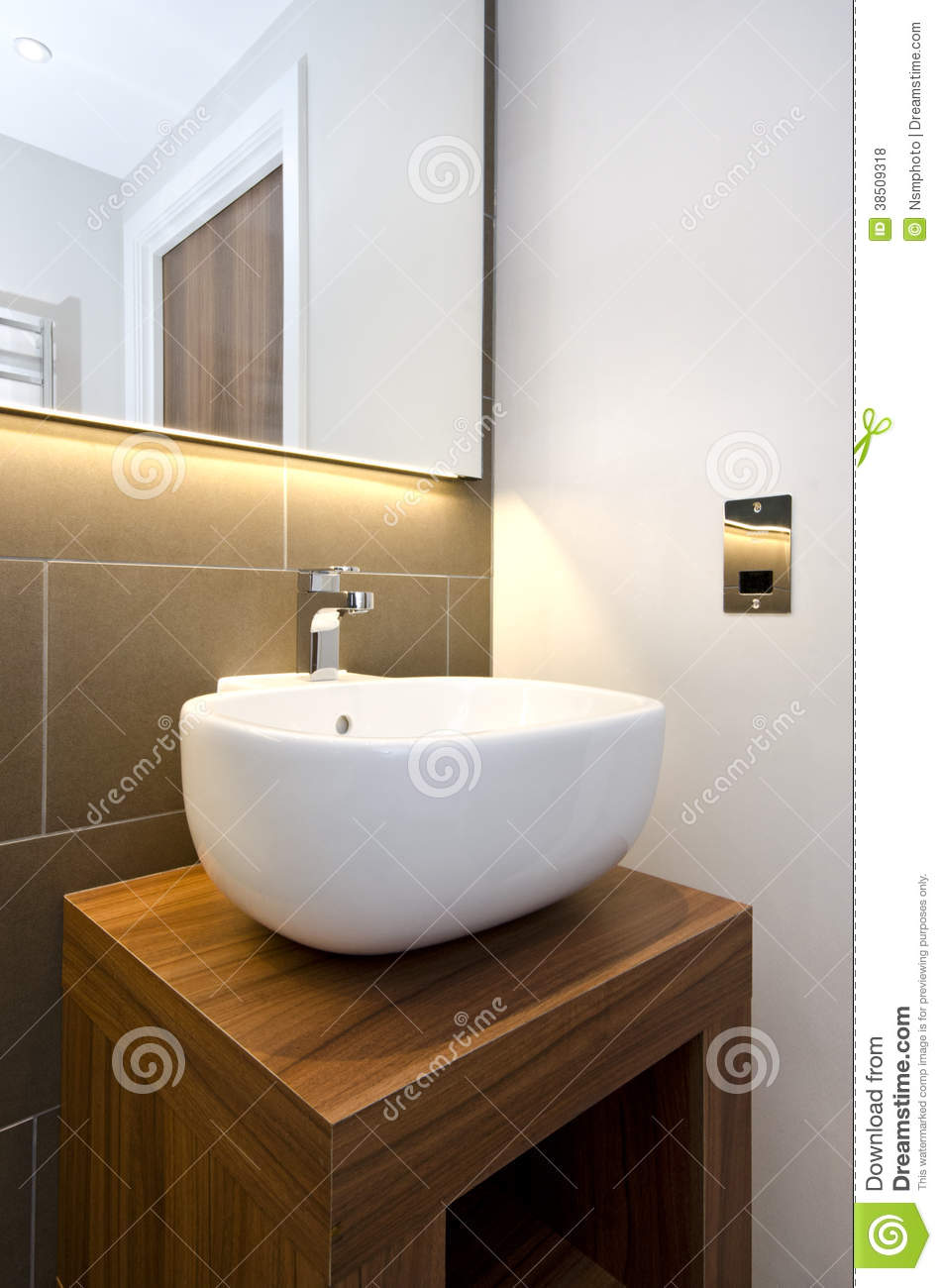 Bathroom detail of a stylish designer hand wash basin with for Latest bathroom sink designs