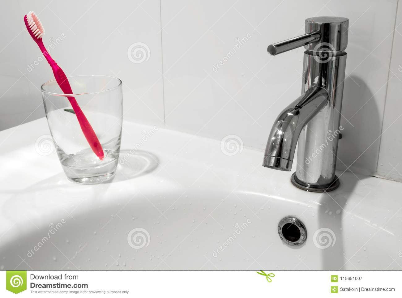 Bathroom Faucet And Wash Basin With Water Glass And Toothbrush Stock ...