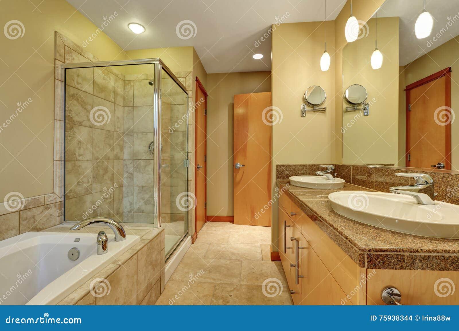 Bathroom Interior In Beige Tones With Vanity Cabinet With Granite ...