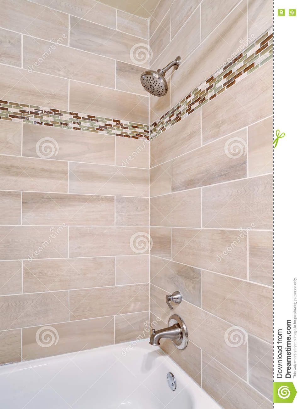 bathroom interior design. view of open shower with tile wall trim