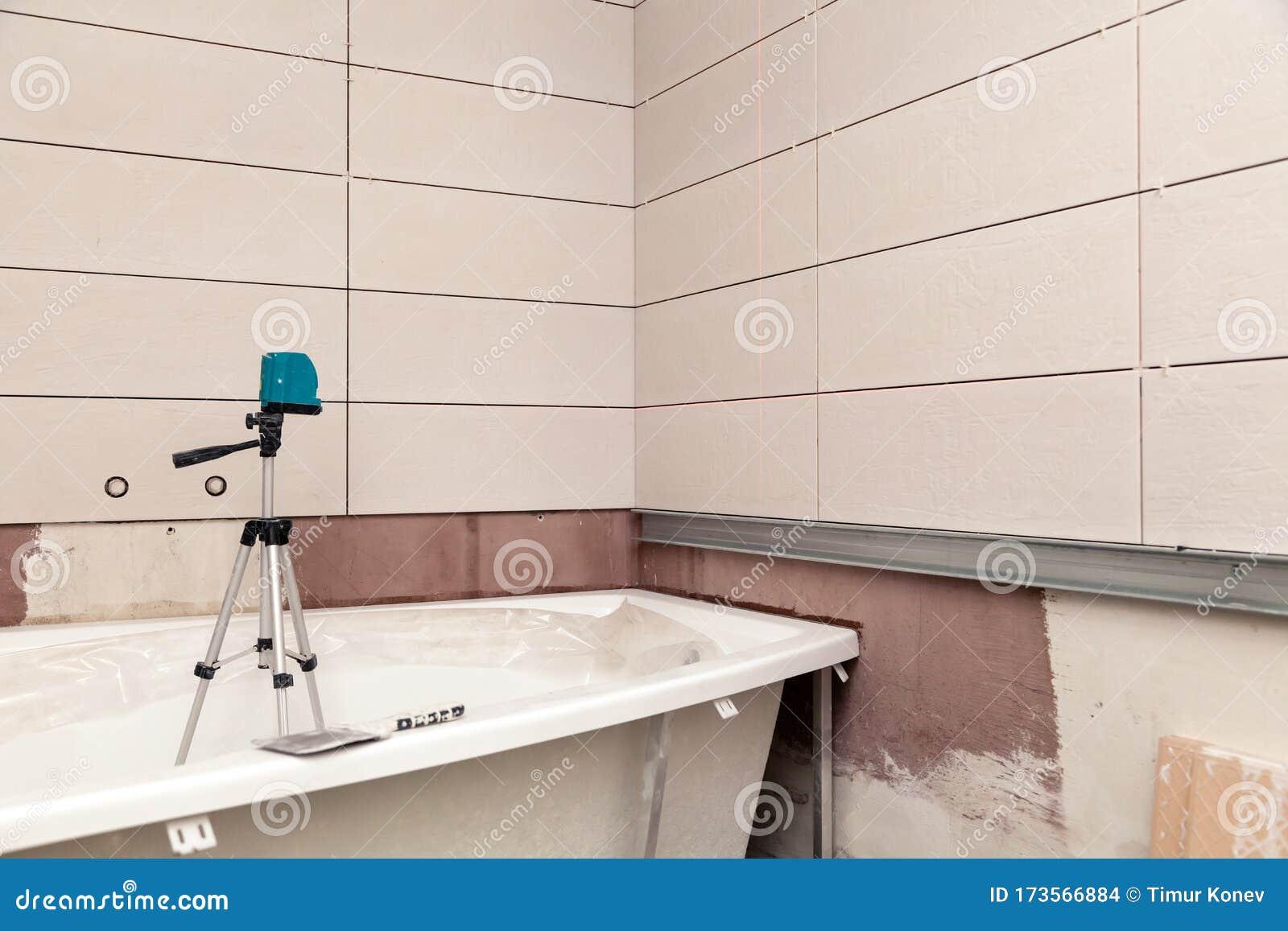 https www dreamstime com bathroom interior repair laying tiles walls close up white rectangular ceramic electronic level bath reconstruction image173566884