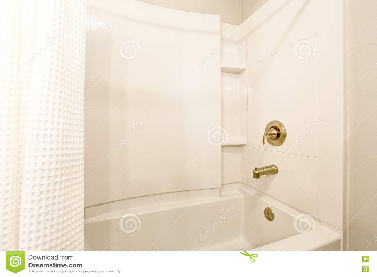 Bathroom Interior View Of White Bath Tub And White Shower Curtain