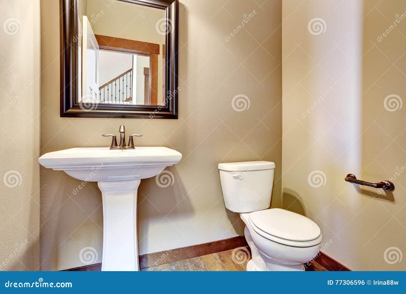 Bathroom Interior. View Of White Sink, Toilet And Mirror Stock Photo ...