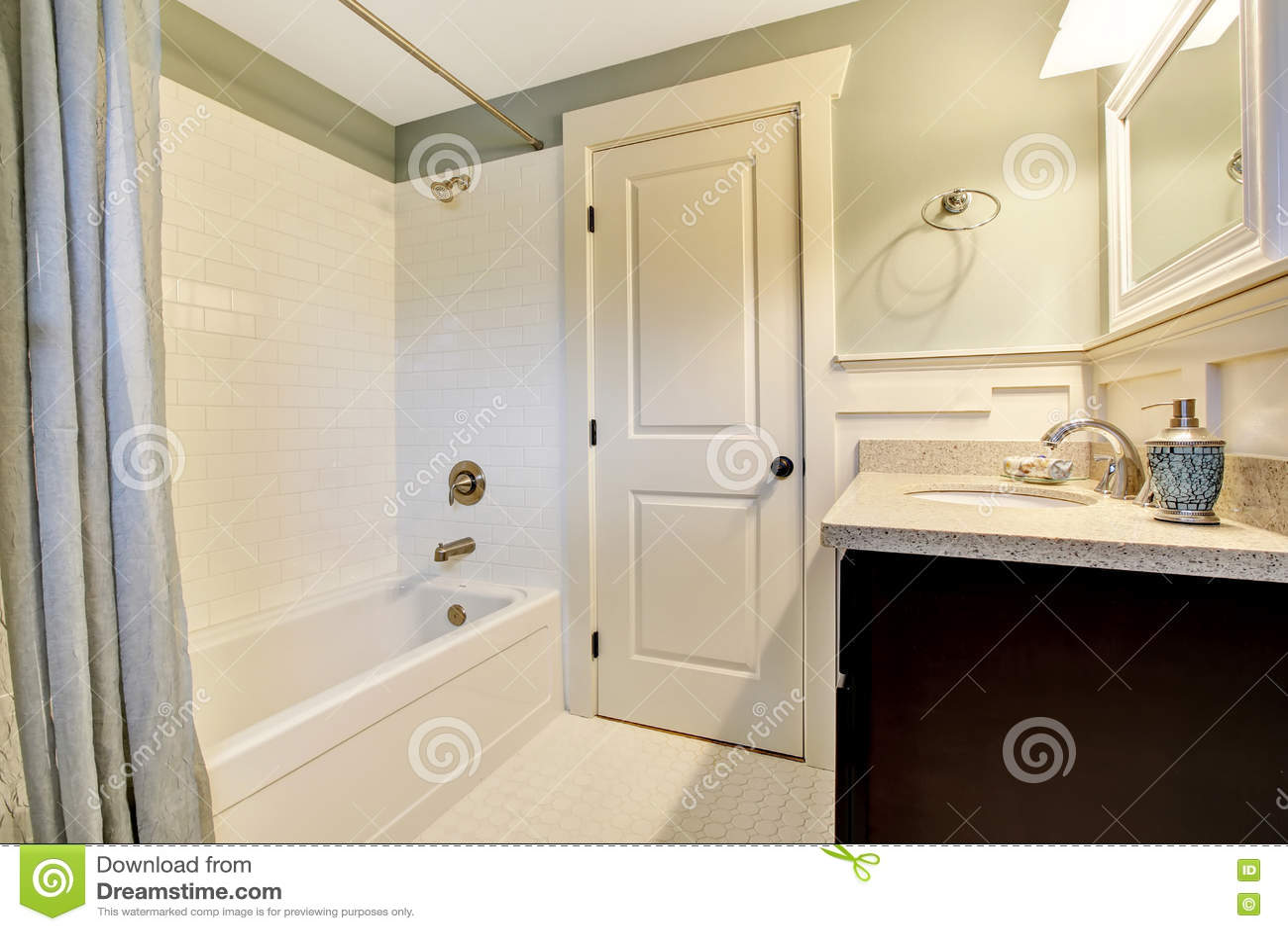 Bathroom Interior In White And Blue Tones With Black Vanity Cabi ...