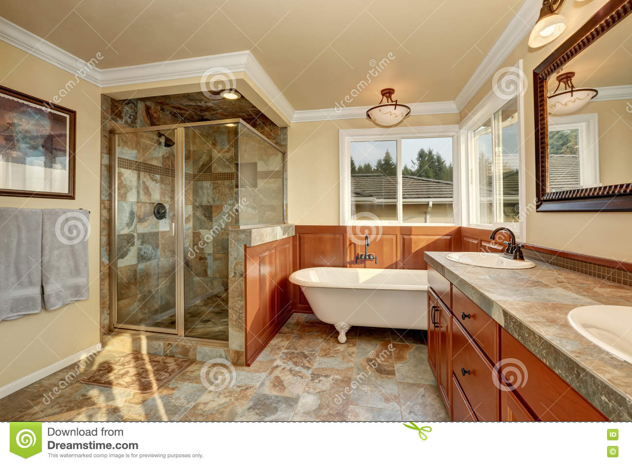 Bathroom With Natural Stone Tile And Beige Walls Stock Photo