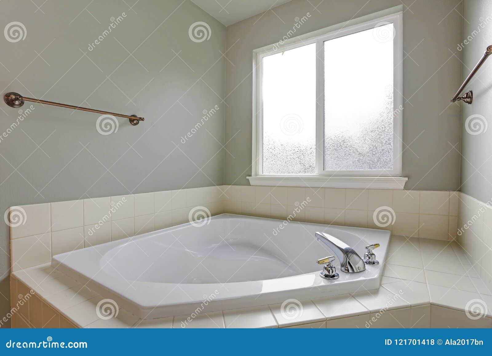 Bathroom Nook Features White Corner Tub Stock Photo - Image of ...