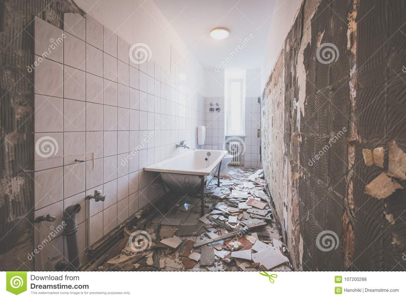 Bathroom Renovation - Removing Tiles In Old Apartment Bathroom Stock ...