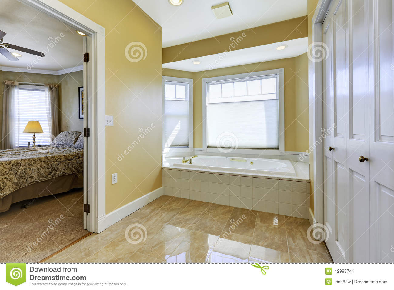 Bathroom With Shiny Tile Floor In Master Bedroom Stock Image Image Of American Ivory 42988741