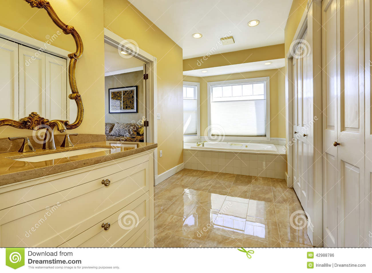 Bathroom with shiny tile floor in master bedroom stock photo bathroom with shiny tile floor in master bedroom dailygadgetfo Images