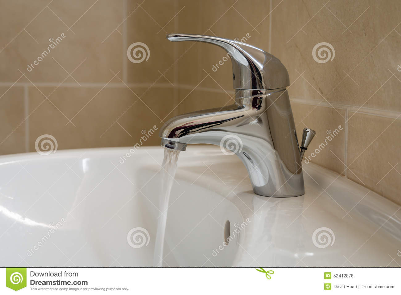 Bathroom sink tap with running water stock photo image for Bathroom sink lever taps