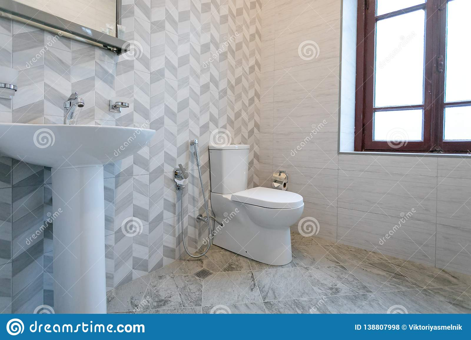 Bathroom With Tiles And Bright Colors Of Broom Shower With Frosted Doors Mirror Above The Sink Hanging A Towel Over The Toilet O Stock Photo Image Of Gray Beautiful 138807998