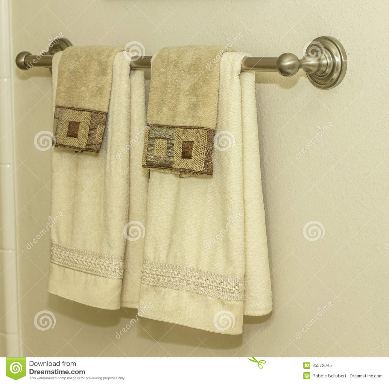 A Bathroom Towel Rack Hanging On A Wall.