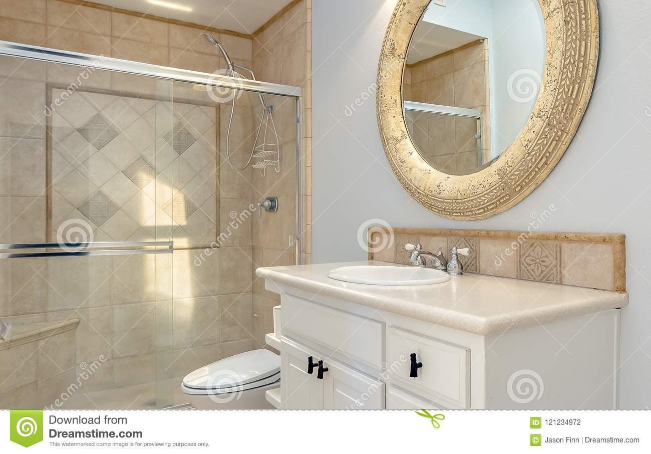 Bathroom With Tub Shower And Glass Doors In Luxury Apartment.  Professionally Installed Brown Tile Sits With Light Coming In From A Sky  Light And A Round ...