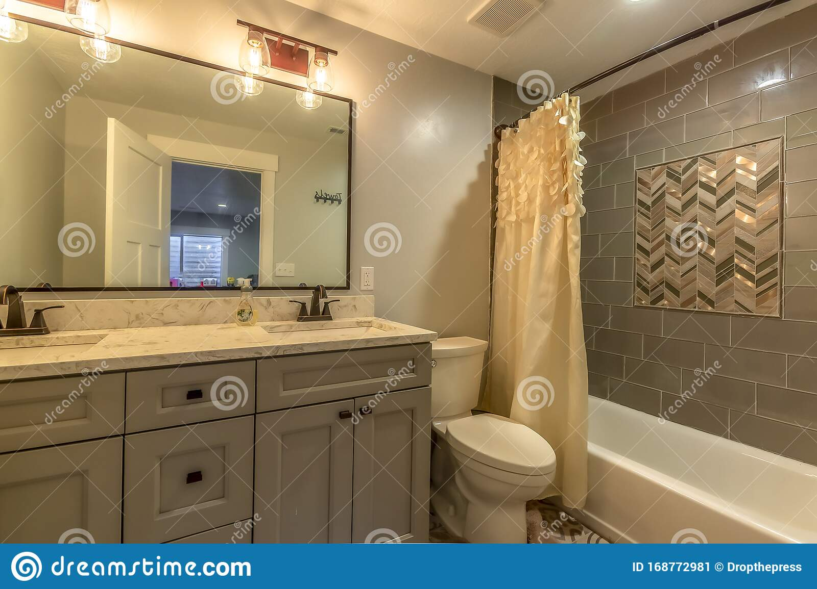 Bathroom With Vanity And Toilet Against White Wall And ...