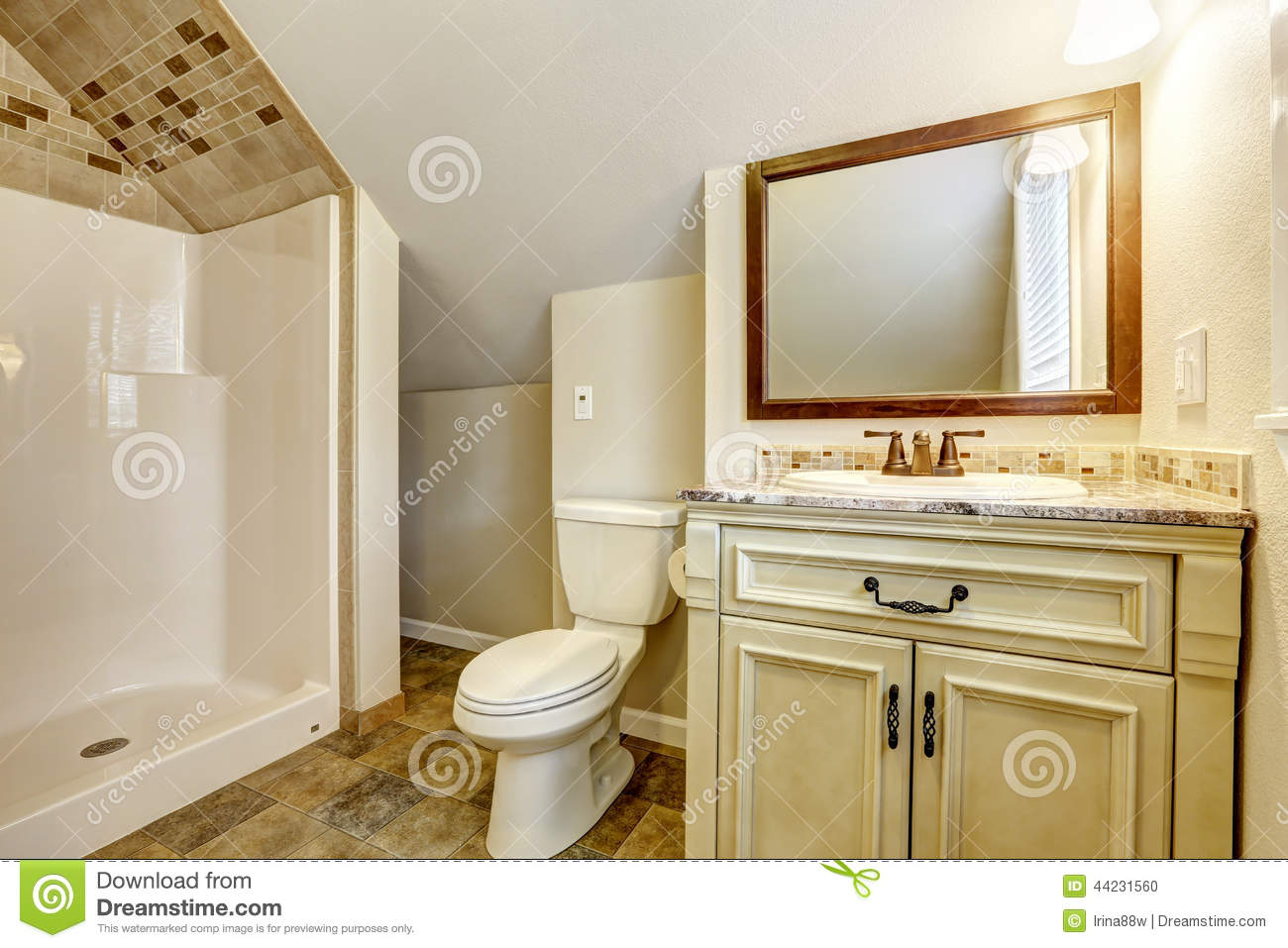 Bathroom With Vaulted Ceiling Vanity Cabinet And Mirror Stock Photo Image Of Building