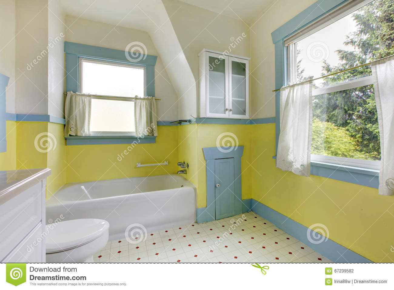 Bathroom With Yellow Walls White Tile Floor And Full Bath