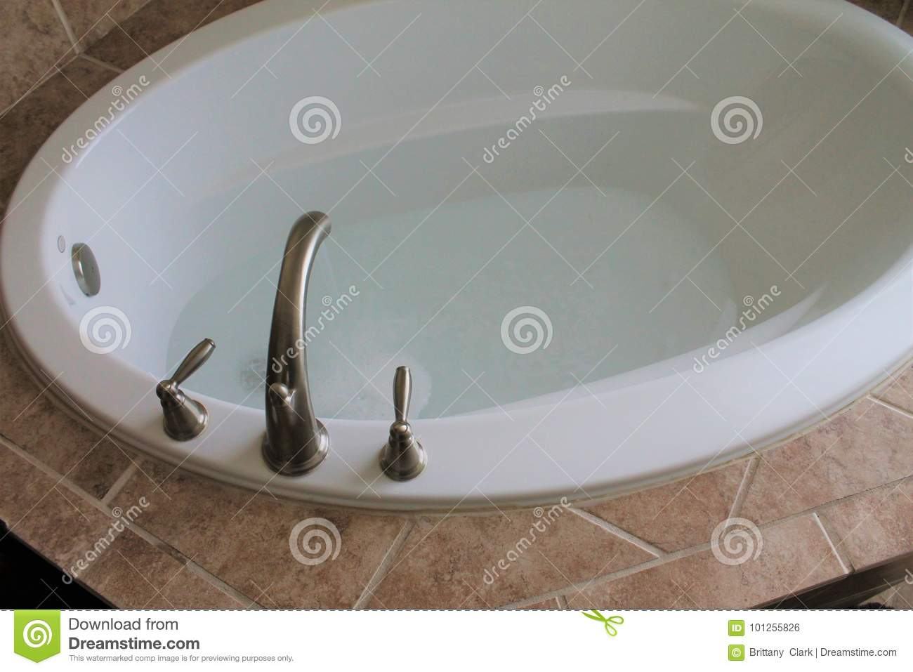 Bathtub Faucet With Water Running In The Bathroom Stock Photo ...