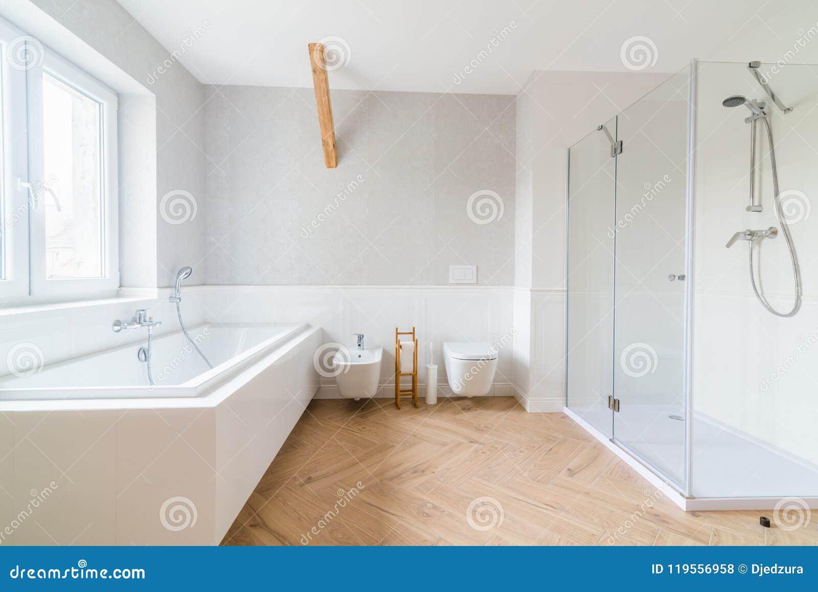 Bathtub And Glass Shower Cabin In Loft Bathroom. Stock Photo - Image ...