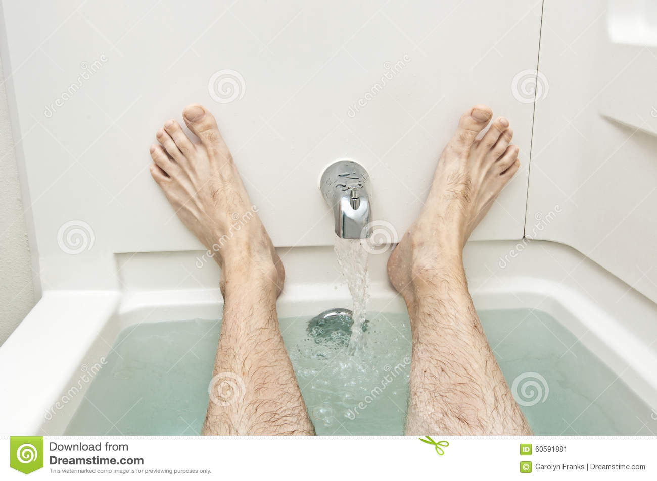 Bathtub With Water Running And Man\'s Feet Stock Image - Image of ...