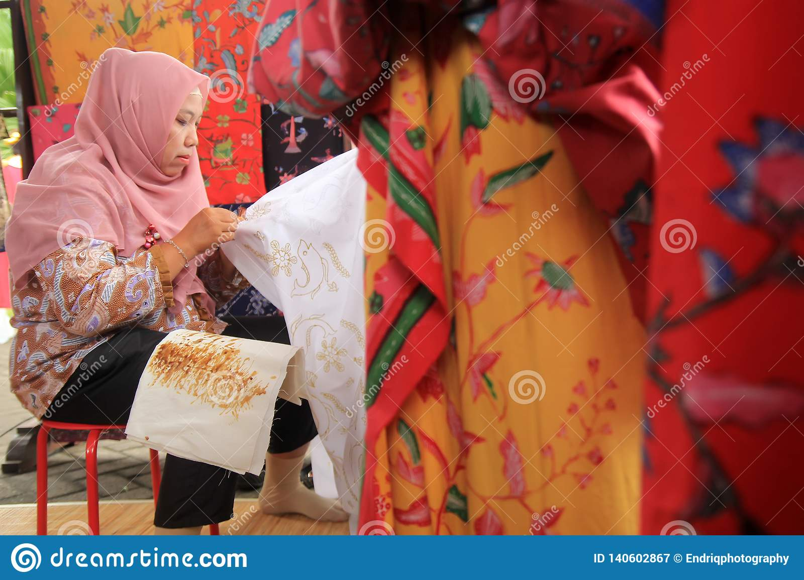 Surabaya indonesia. August 20, 2015. A woman makes a batik motif using canting