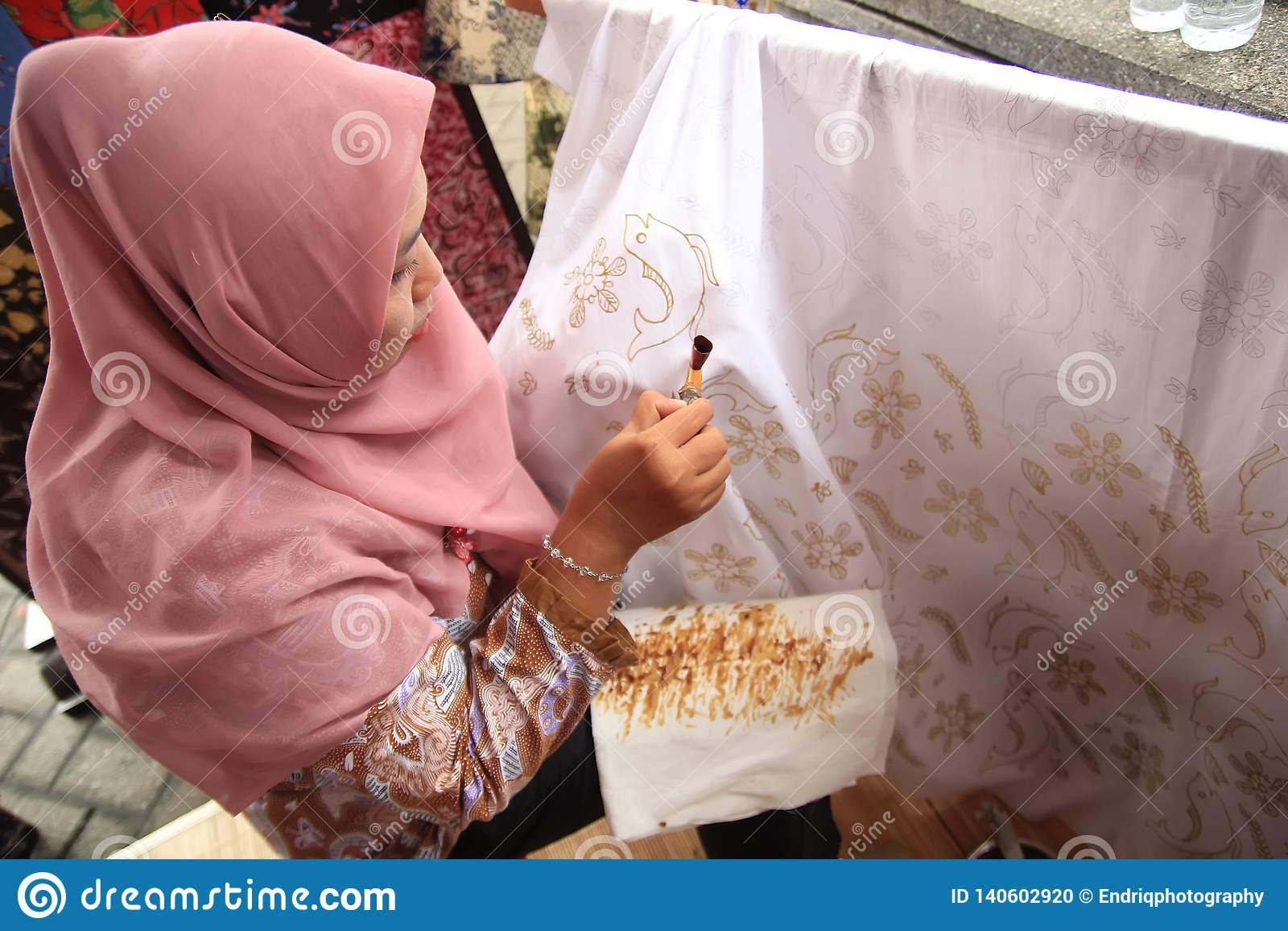 Surabaya indonesia. August 20, 2015. A woman makes a batik motif using canting