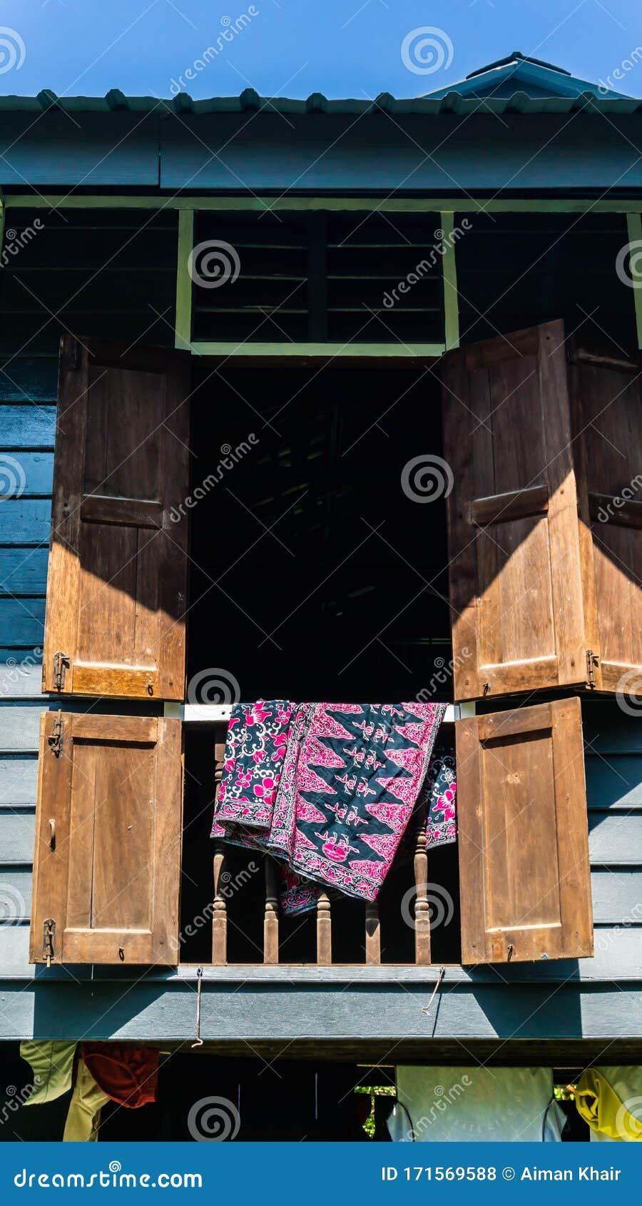Batik Fabric Hanging On The Window Of Rumah Kampung Under The Bright Sunlight Stock Photo Image Of Classic Blue 171569588