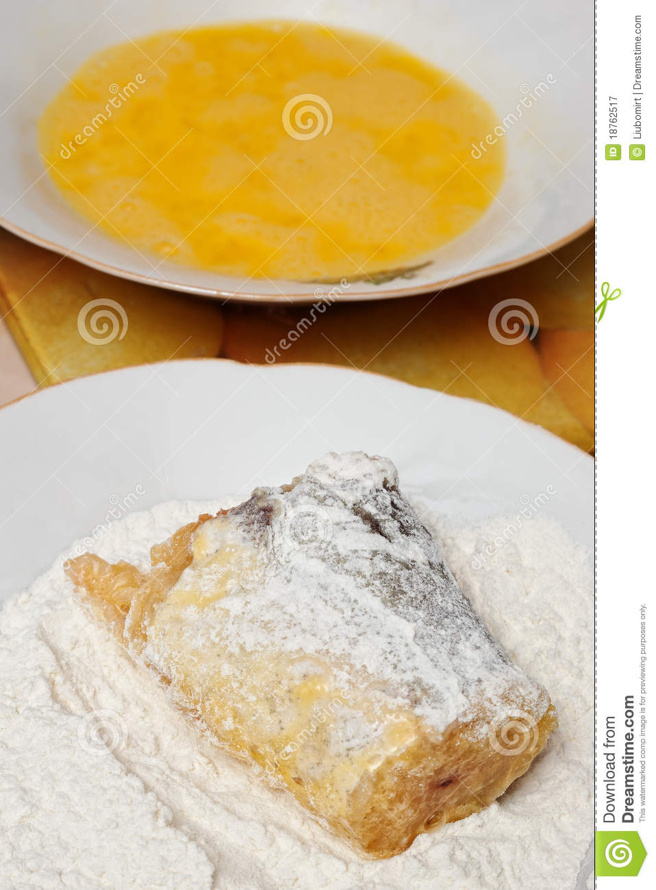 Battering fish in flour royalty free stock photography for How to fry fish with egg and flour