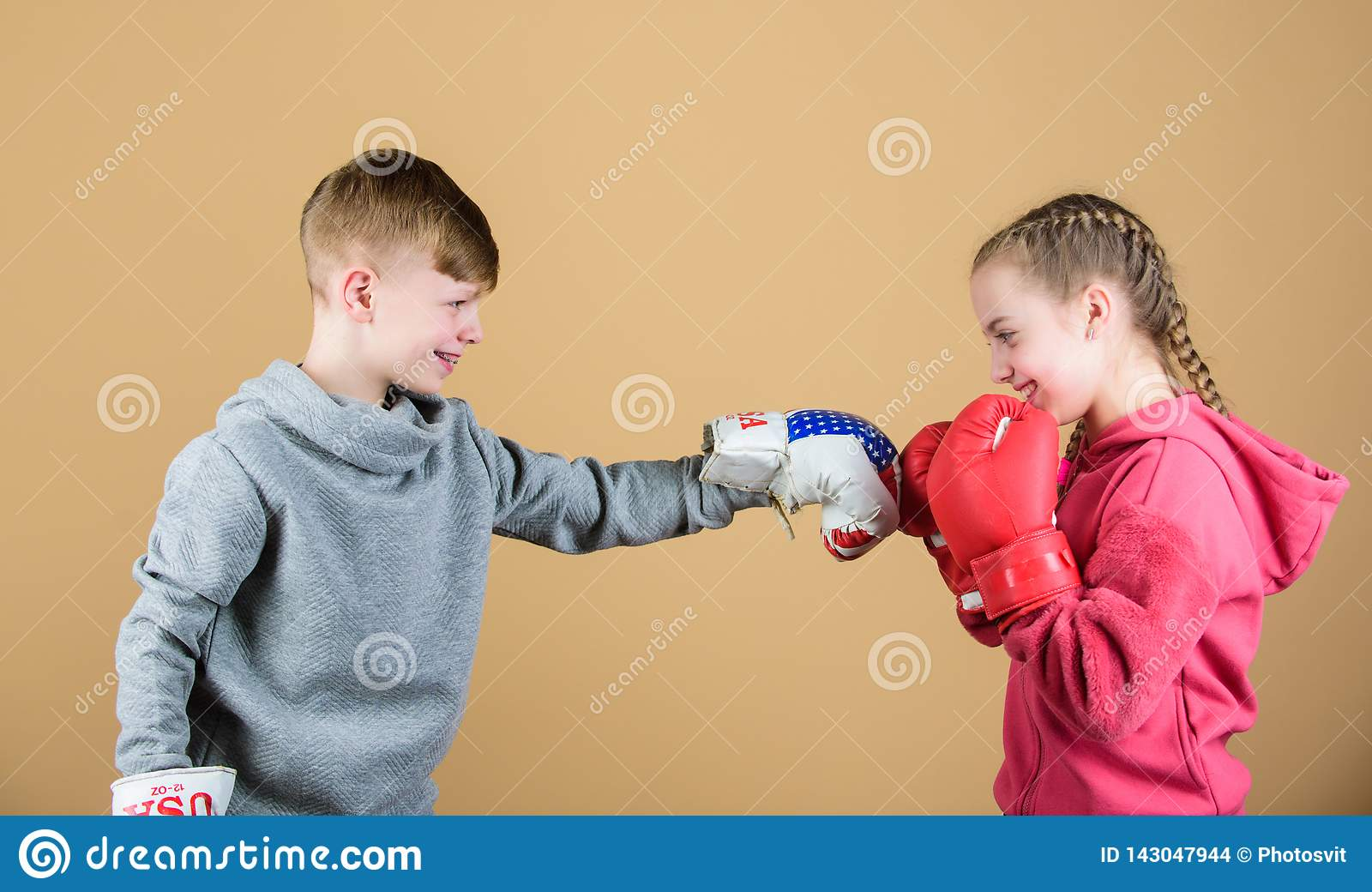 Battle for attention. Child sporty athlete practicing boxing skills. Boxing sport. Children wear boxing gloves while
