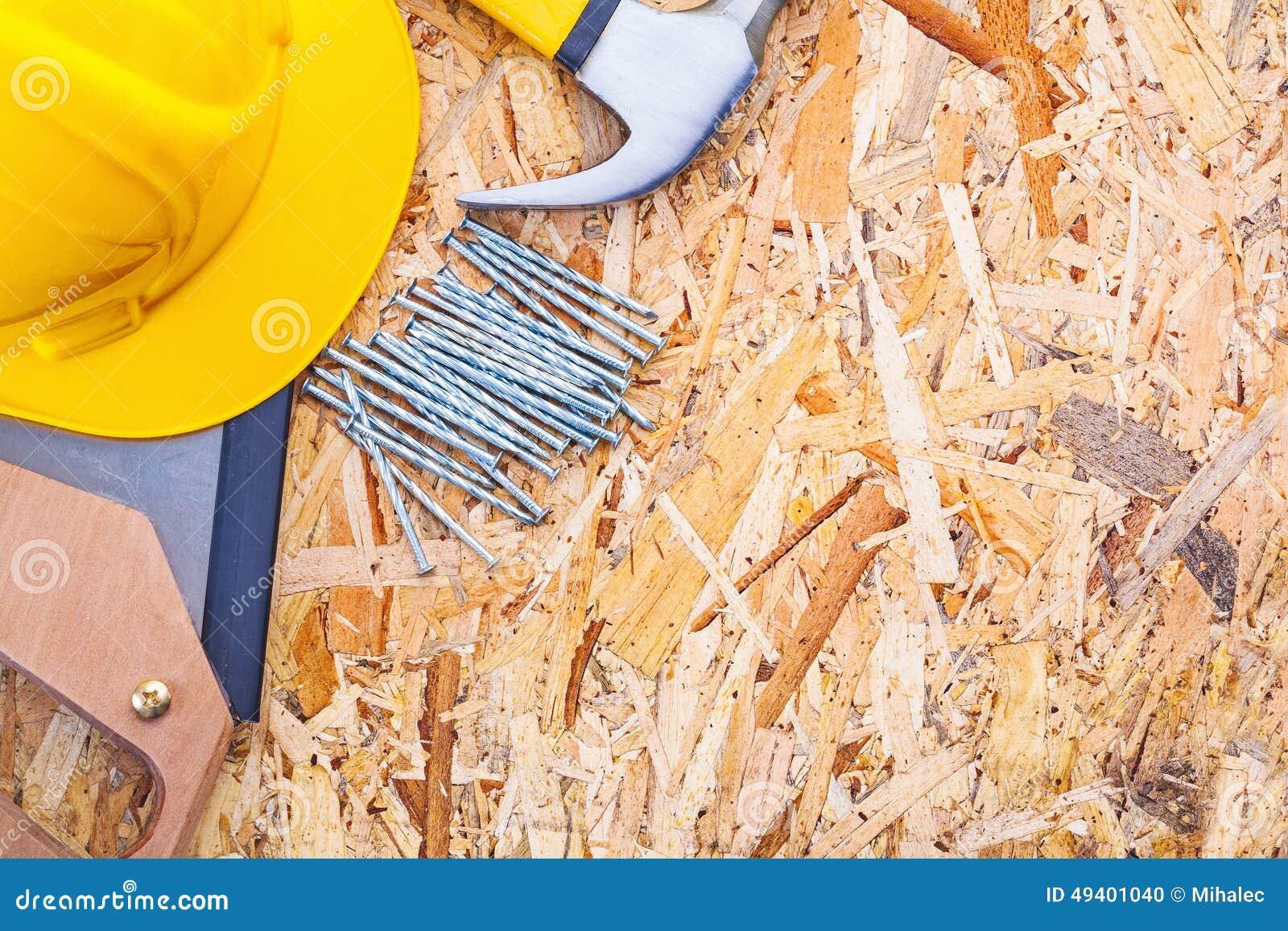 Download Bau Bearbeitet Sturzhelm Handsawtischlerhammer Stockfoto - Bild von gekörnt, chipboard: 49401040
