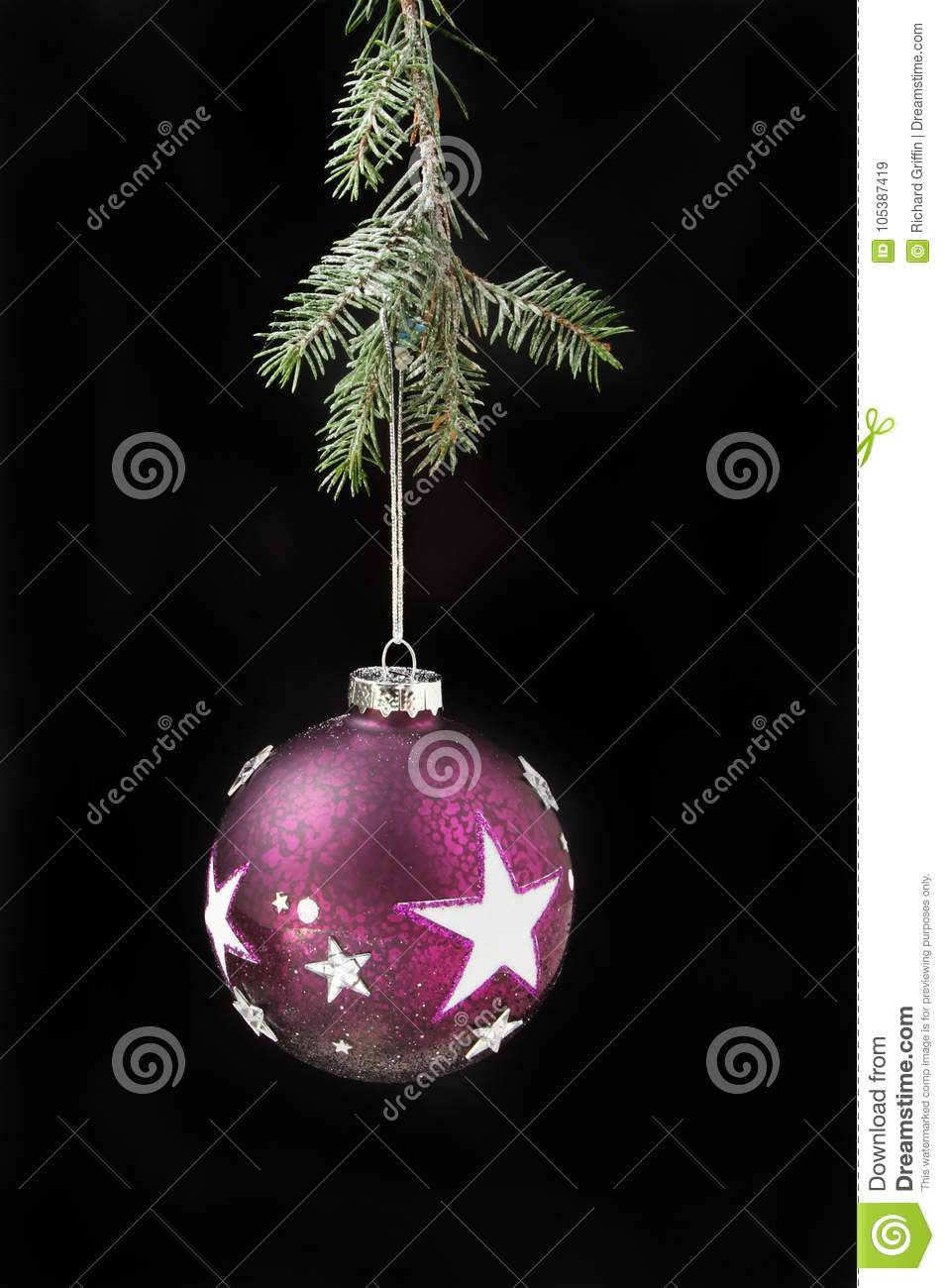 Bauble with stars against black