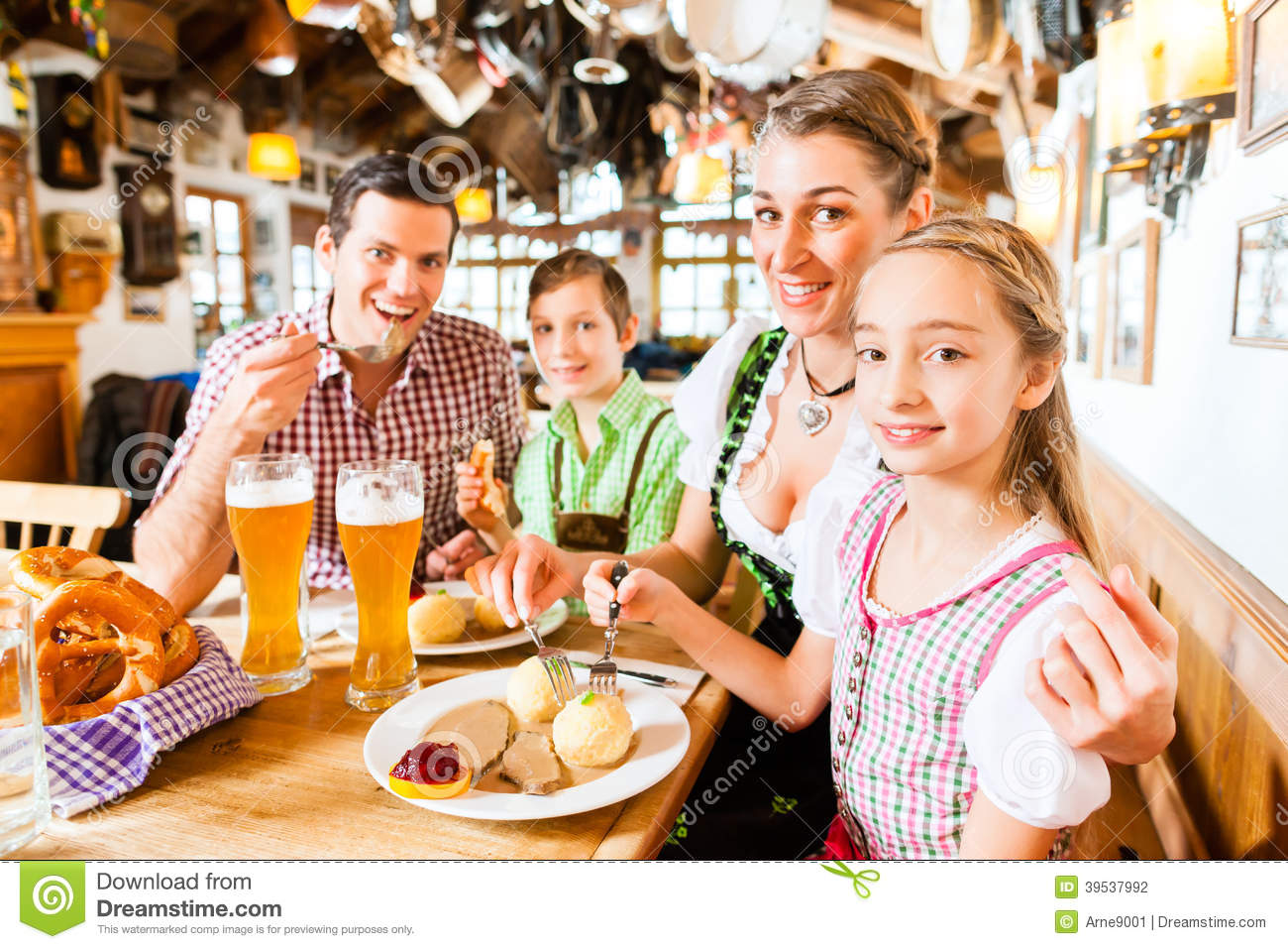 Bavarian family in german restaurant eating stock photo image