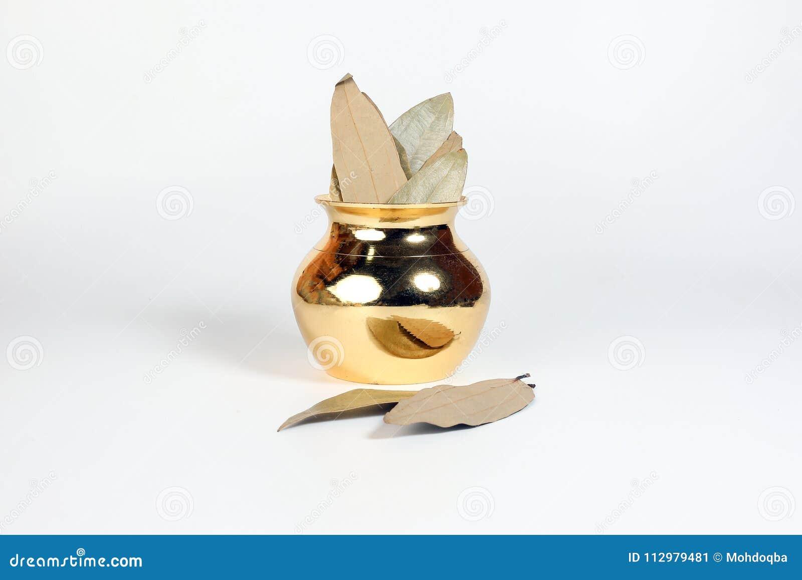 Bay leaf spice in shiny metal po