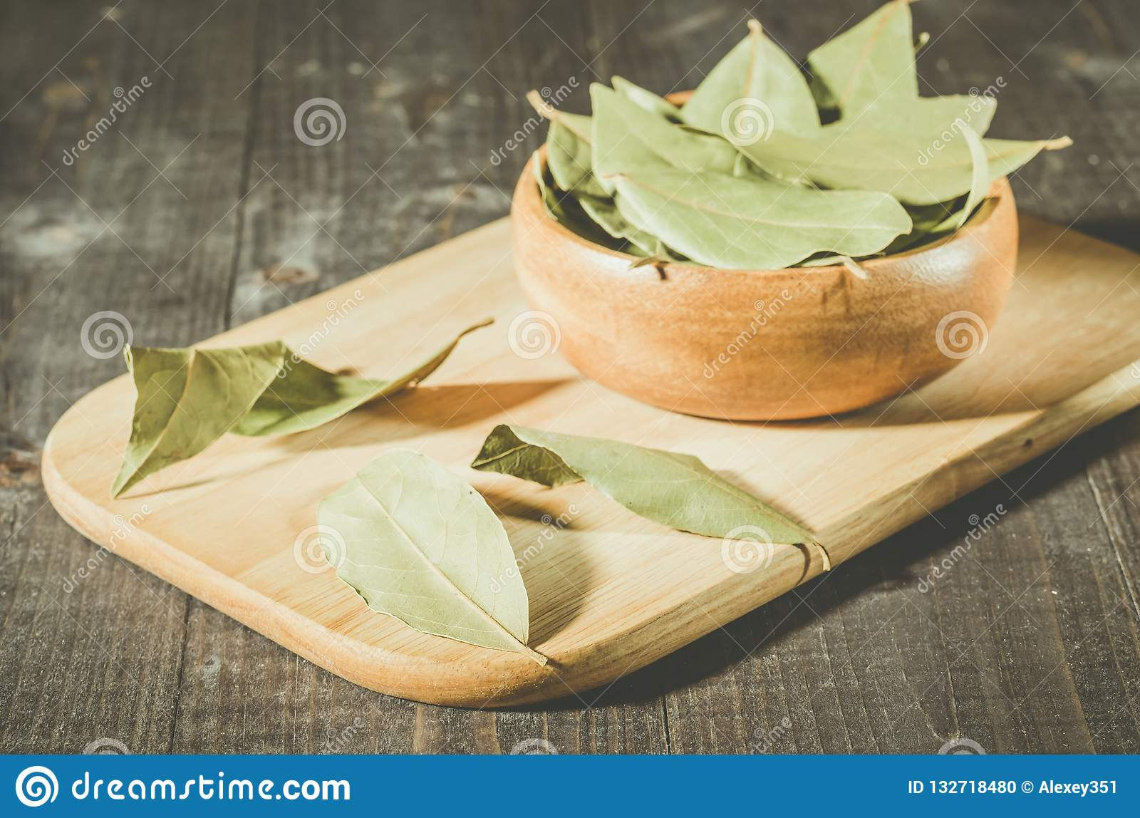 Bay leaf on a tray in a wooden bowl/bay leaf in a wooden plate o