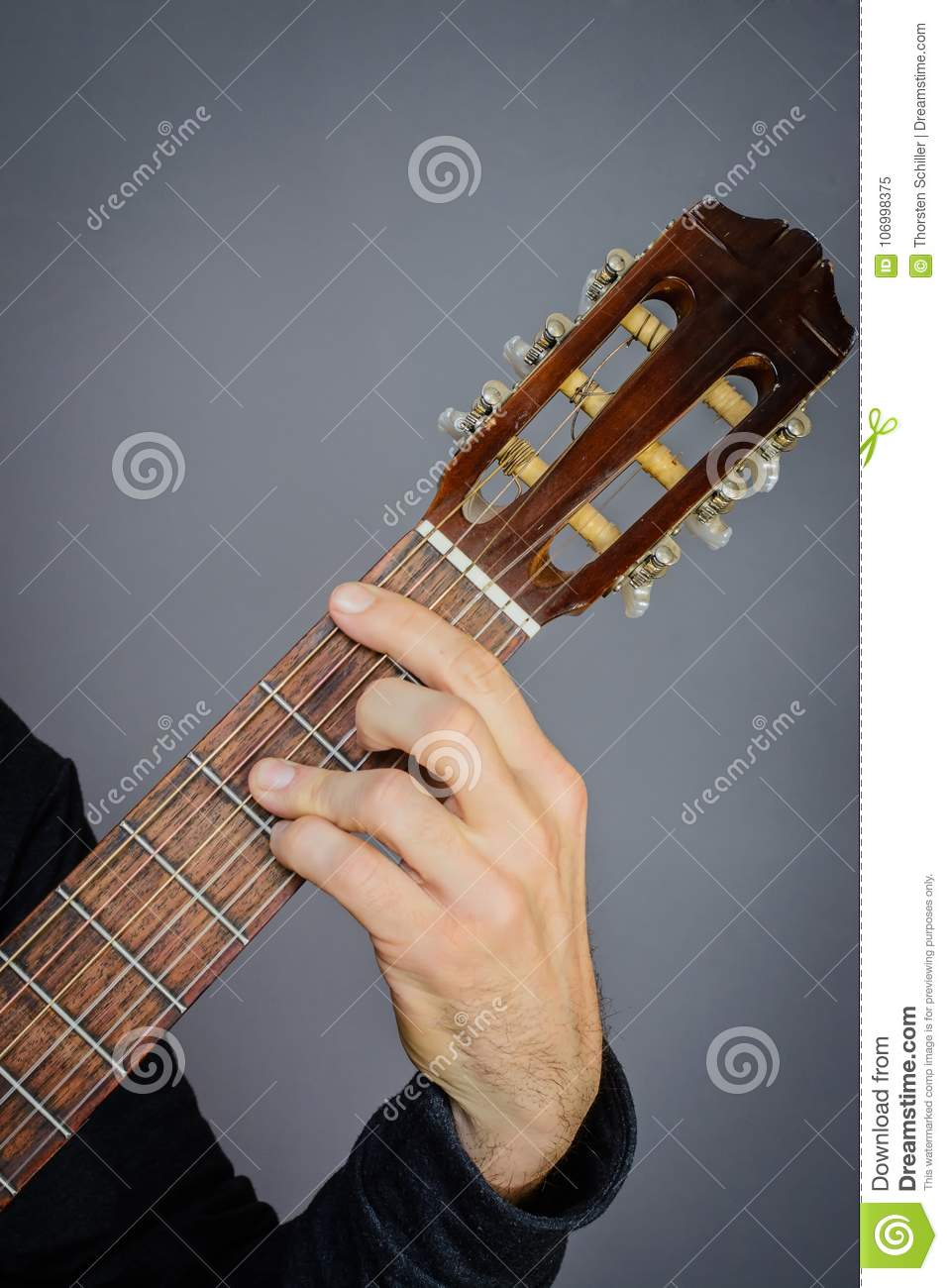 Bb Major Chord Played By Guitarist On Classical Acoustic Guitar