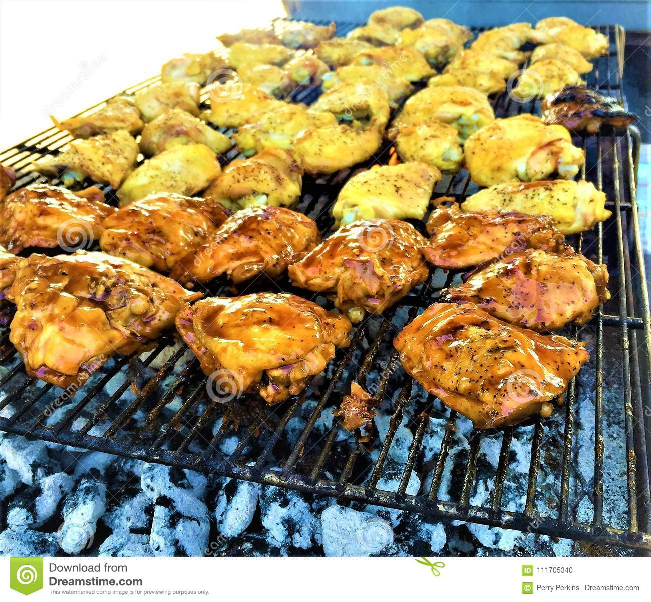 BBQ Grilled Chicken Thighs Over Charcoal Stock Photo