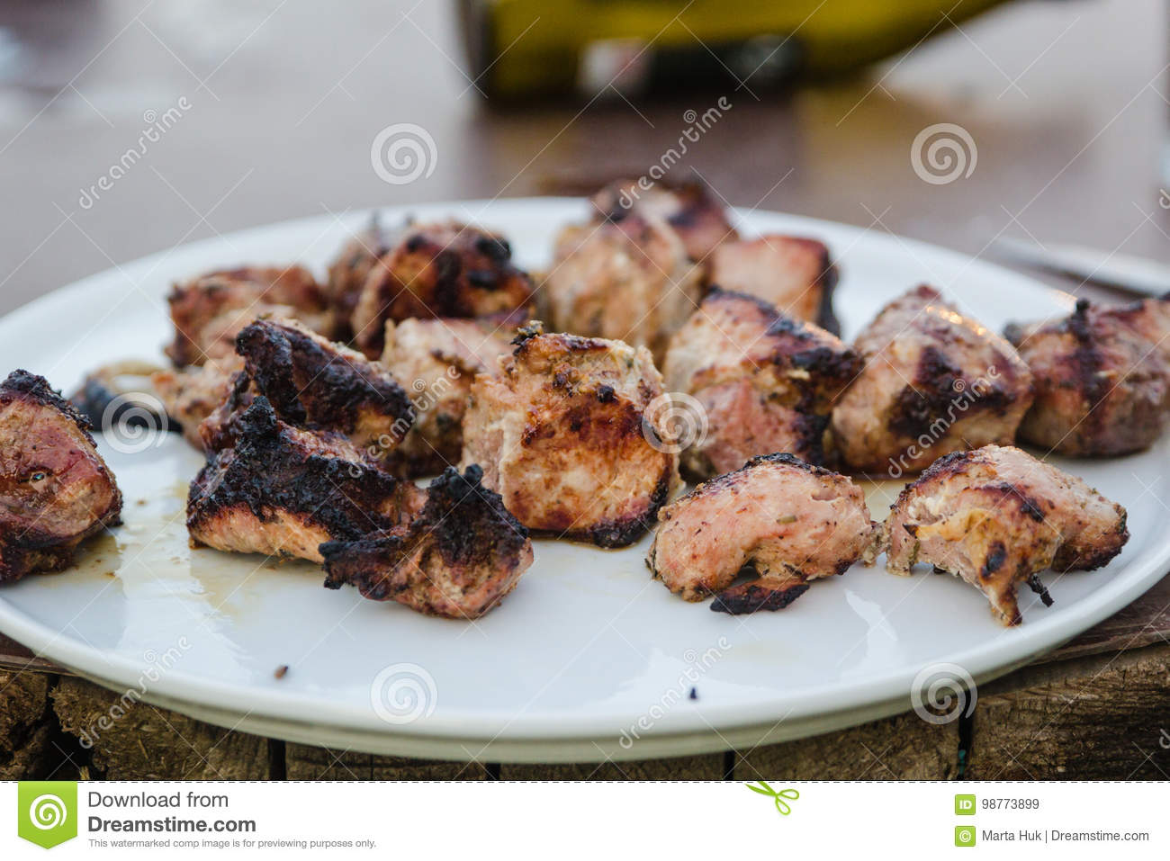 BBQ meat on grill in garden