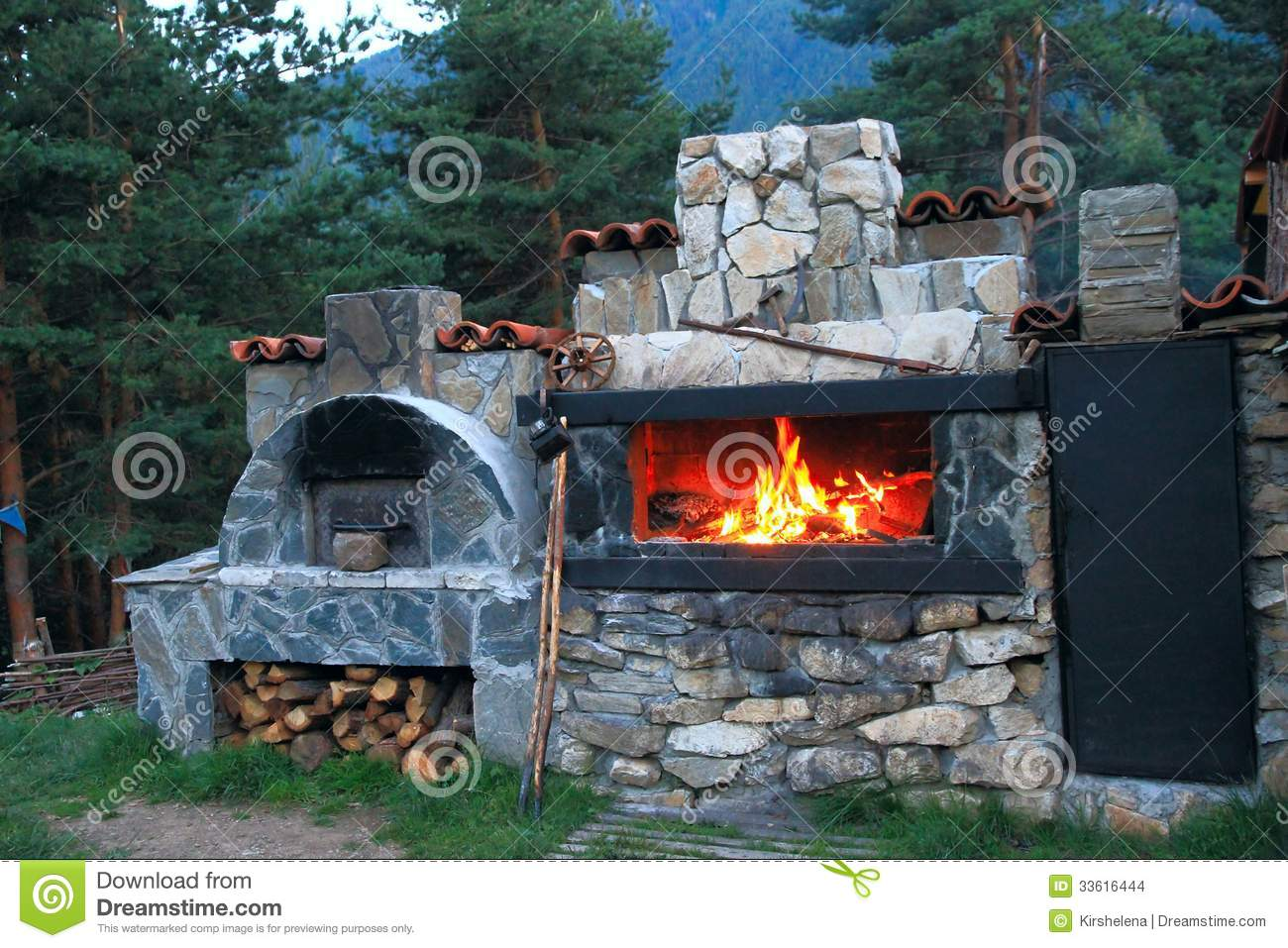 BBQ Oven Made Of Stone In The Courtyard House Stock