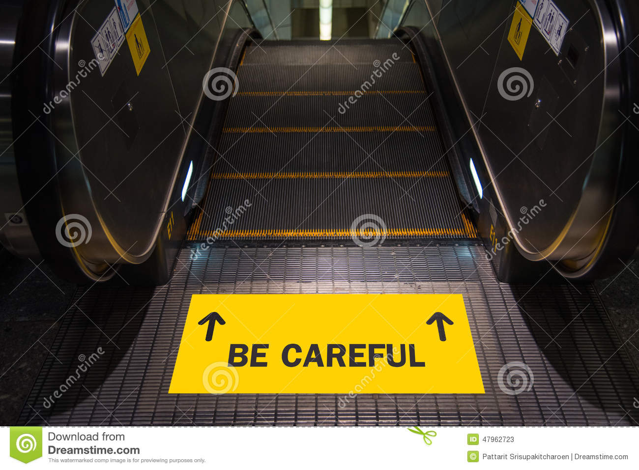 Be Careful Text On Yellow Label At Escalator Stock Photo