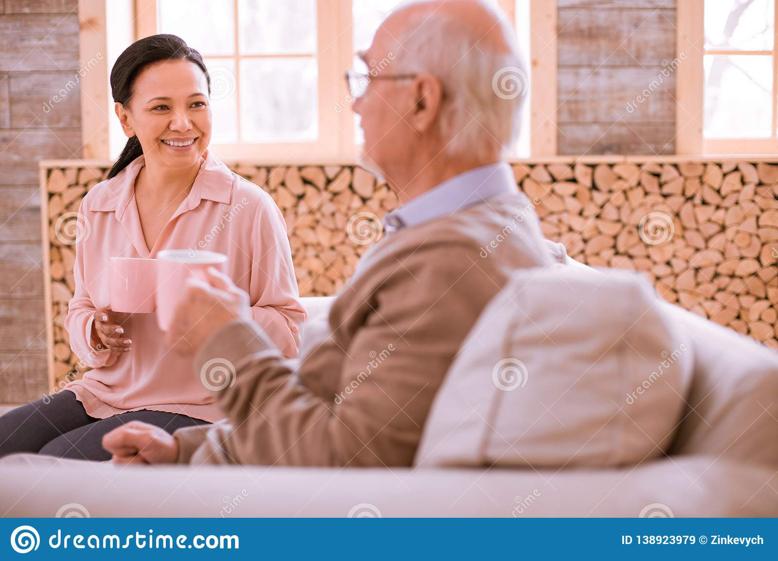 Positive delighted Asian woman having pleasant talk