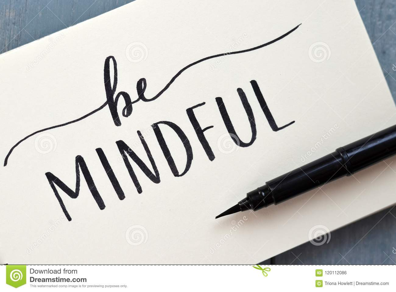 BE MINDFUL hand-lettered in notepad with brush pen