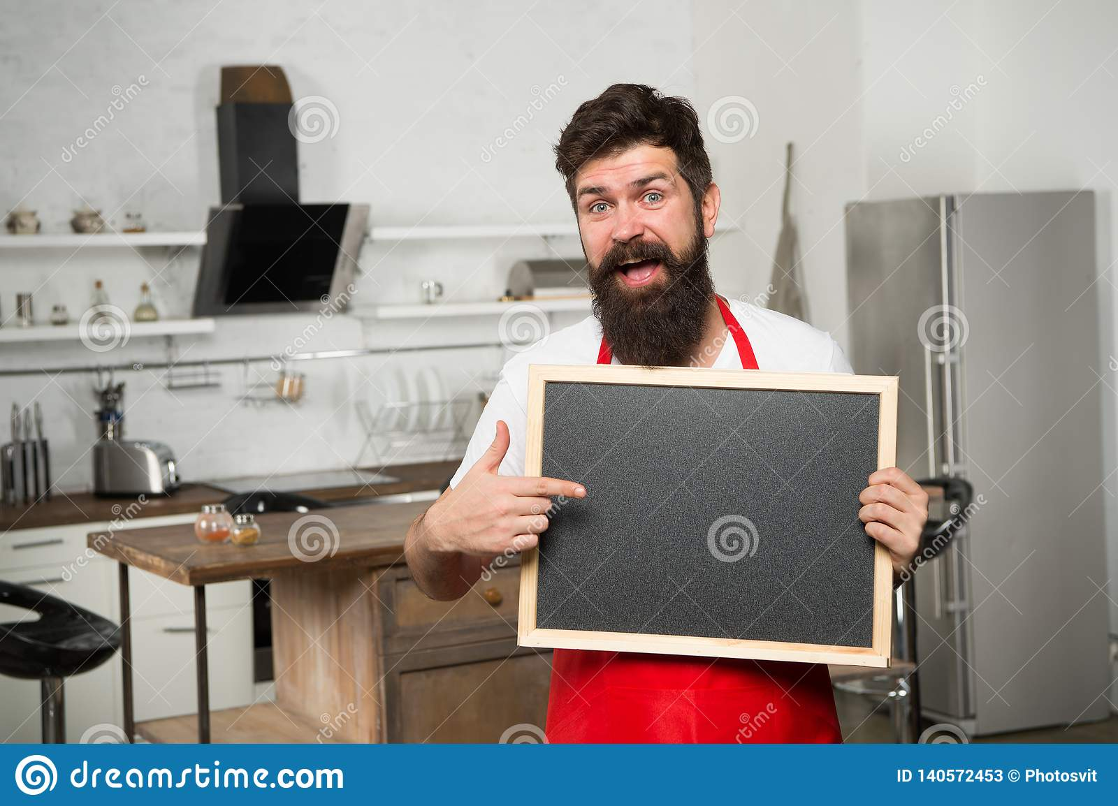 Be our guest. Restaurant or cafe menu. Advertisement. Man chef with board, copy space. Mature male. Bearded man cook