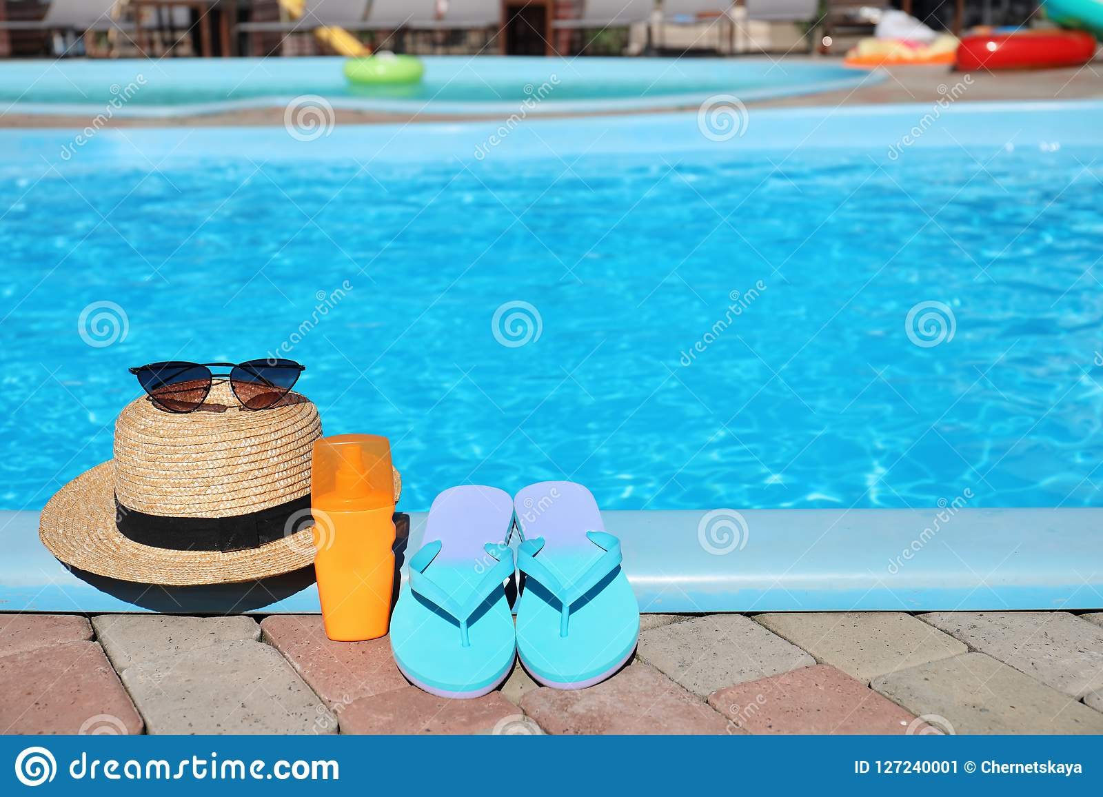 Beach Accessories Near Swimming Pool On Sunny Day Stock ...