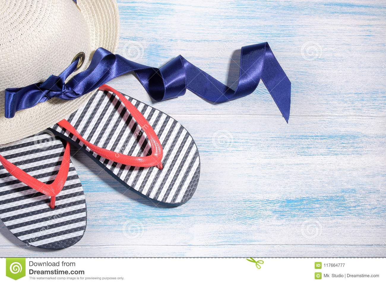 aad88b8f1136 Beach accessories. summer hat with flakes on a blue wooden background.