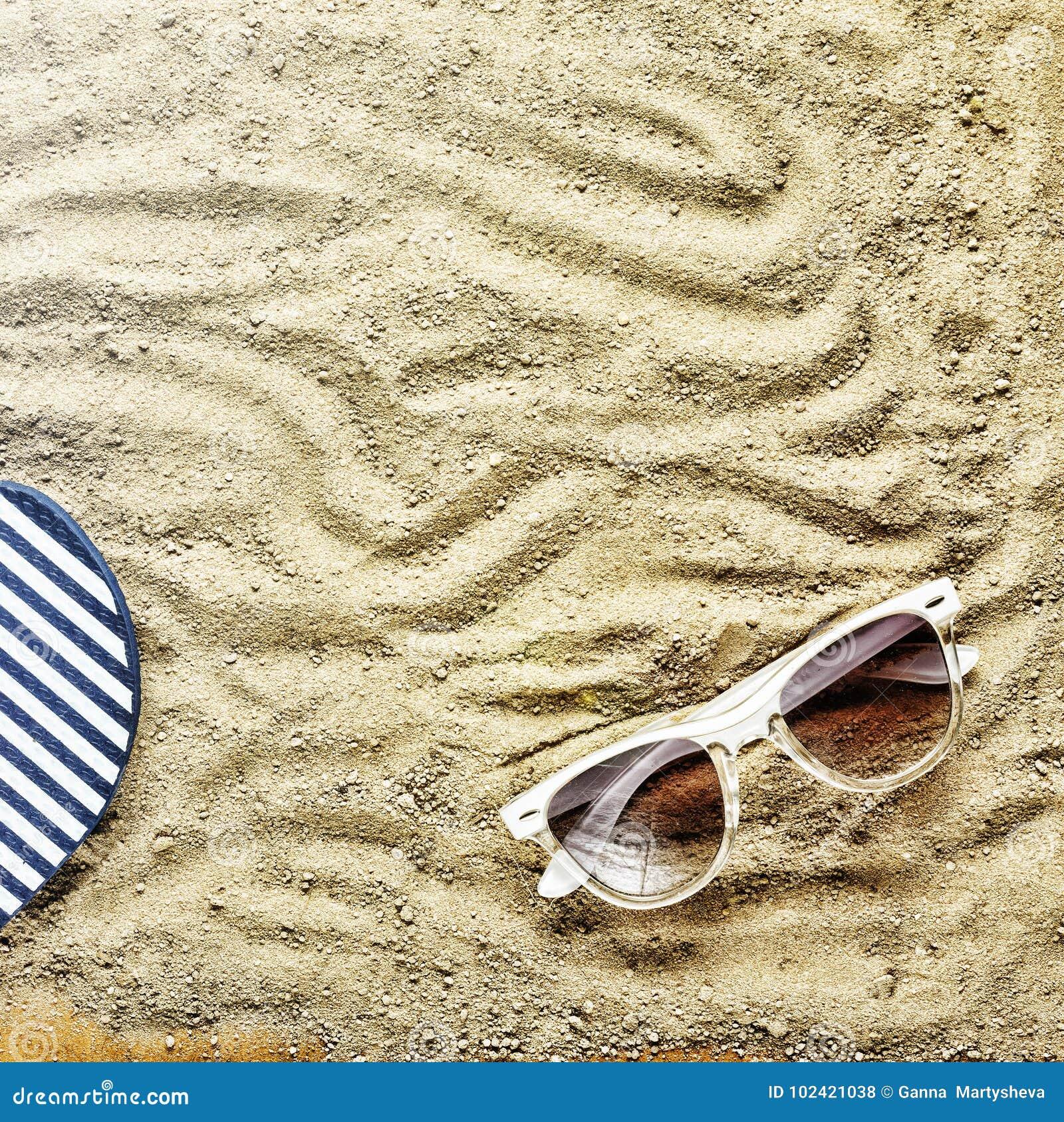 Beach Background. Beach Slippers And Sunglasses Stock